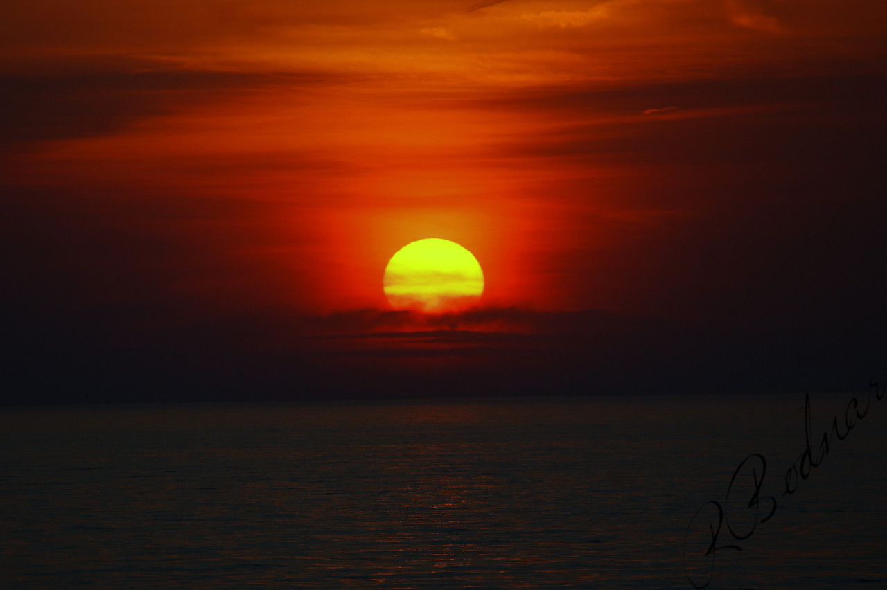 Photo By Robert Bodnar............................. lone sunset in lorain Ohio