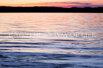 Sunset and the beautiful reflection in the smooth waters of Lake Leelanau