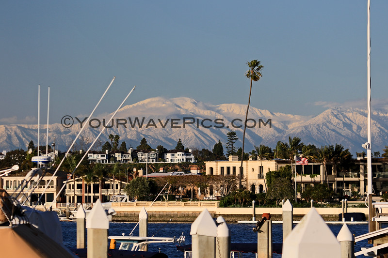 2019-02-06_Balboa_Buena Vista Snow_4.JPG<br /> <br /> A rare day with snow-covered mountains behind Newport Harbor, viewed from Buena Vista Dr.