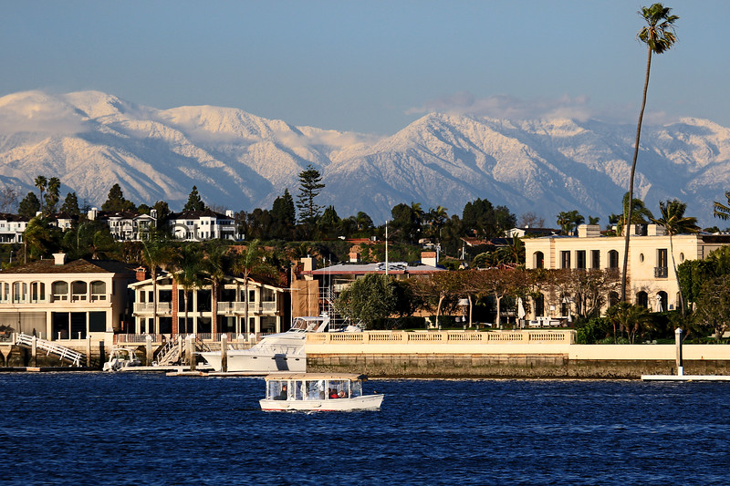 2019-02-06_Balboa_Buena Vista Snow_18.JPG<br /> <br /> A rare day with snow-covered mountains behind Newport Harbor, viewed from Buena Vista Dr.