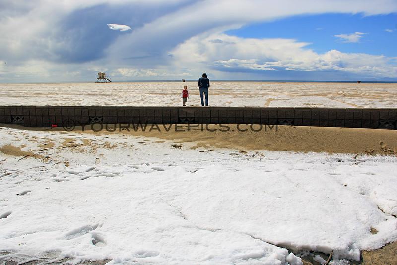 2015-03-02_9511_Magnoiia St.JPG<br /> <br /> Hail at Huntington State Beach turns the beach into a winter wonderland