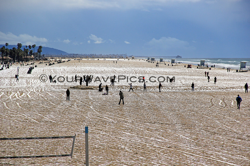 2015-03-02_9545_HB Pier Southside.JPG<br /> <br /> Quickly melting hail on the sand at Huntington Beach 3/2/15