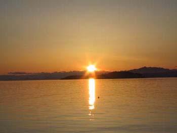 Sun setting behind Trail Islands