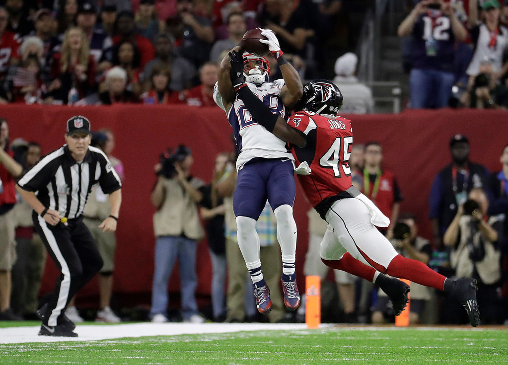 . New England Patriots\' James White, top, catches a pass against Atlanta Falcons\' Deion Jones during the first half of the NFL Super Bowl 51 football game Sunday, Feb. 5, 2017, in Houston. (AP Photo/Chuck Burton)