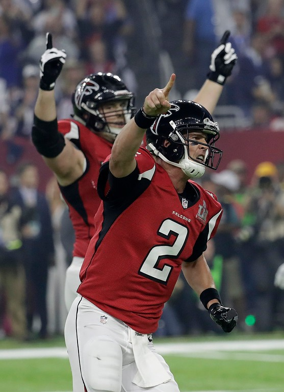 . Atlanta Falcons\' Matt Ryan (2) celebrates with Ryan Schraeder after a touchdown during the second half of the NFL Super Bowl 51 football game against the New England Patriots Sunday, Feb. 5, 2017, in Houston. (AP Photo/Eric Gay)