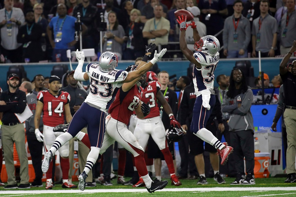 . New England Patriots\' Duron Harmon makes a catch over New England Patriots\' Kyle Van Noy, during the second half of the NFL Super Bowl 51 football game against the Atlanta Falcons, Sunday, Feb. 5, 2017, in Houston. (AP Photo/Patrick Semansky)