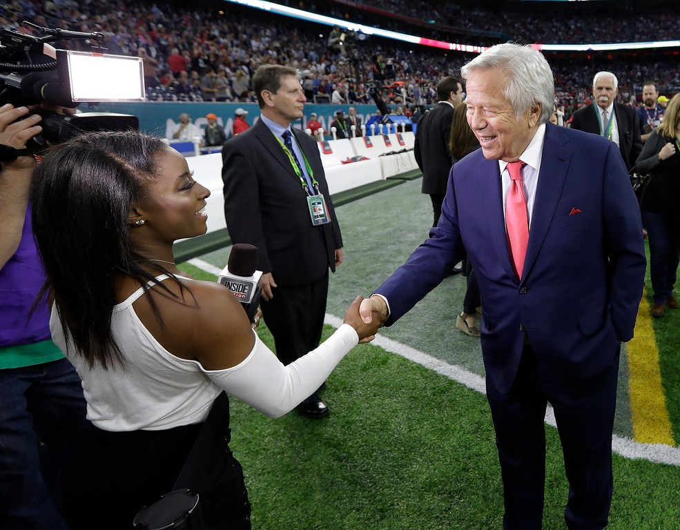 . Olympic gold medalist Simone Biles shakes hands with New England Patriots owner Robert Kraft before the NFL Super Bowl 51 football game against the Atlanta Falcons Sunday, Feb. 5, 2017, in Houston. (AP Photo/David J. Phillip)