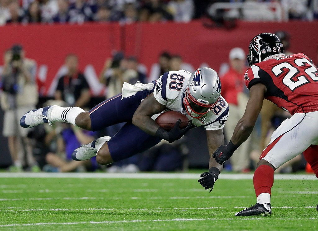 . New England Patriots\' Martellus Bennett (88) makes a reception against Atlanta Falcons\' Keanu Neal (22) during the first half of the NFL Super Bowl 51 football game Sunday, Feb. 5, 2017, in Houston. (AP Photo/Mark Humphrey)
