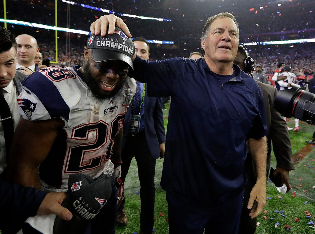 . New England Patriots head coach Bill Belichick celebrates with James White after the NFL Super Bowl 51 football game against the Atlanta Falcons Sunday, Feb. 5, 2017, in Houston. The Patriots won 34-28 in overtime. (AP Photo/Eric Gay)