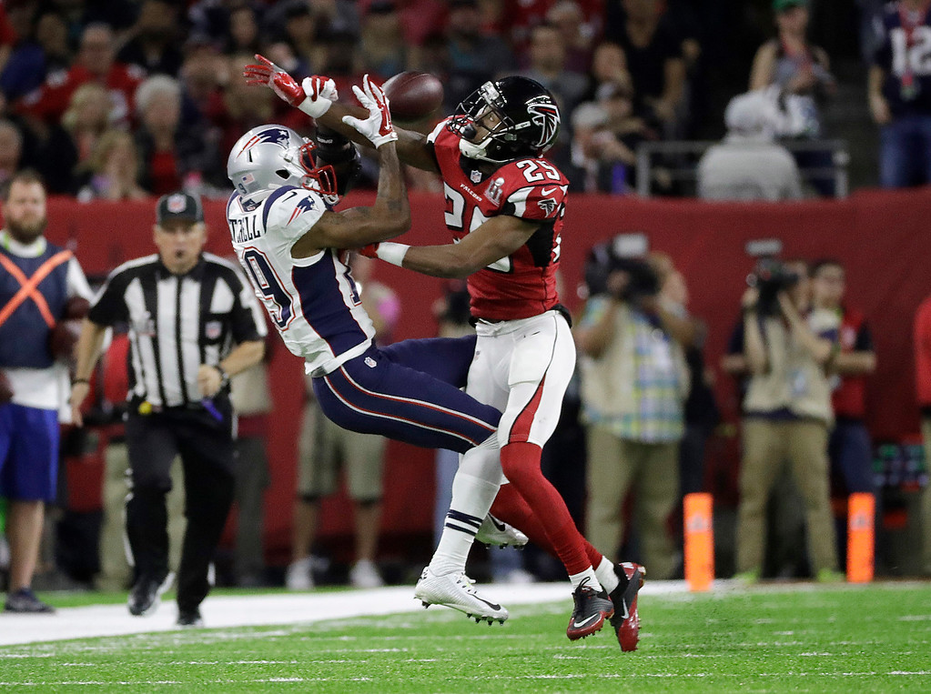 . Atlanta Falcons\' C.J. Goodwin, right, breaks up a pass intended for New England Patriots\' Malcolm Mitchell during the first half of the NFL Super Bowl 51 football game Sunday, Feb. 5, 2017, in Houston. (AP Photo/Chuck Burton)