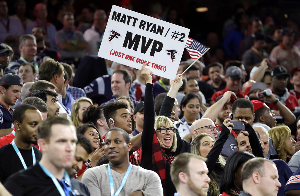 . Fans cheer during the first half of the NFL Super Bowl 51 football game between the Atlanta Falcons and the New England Patriots, Sunday, Feb. 5, 2017, in Houston. (AP Photo/Mark Humphrey)