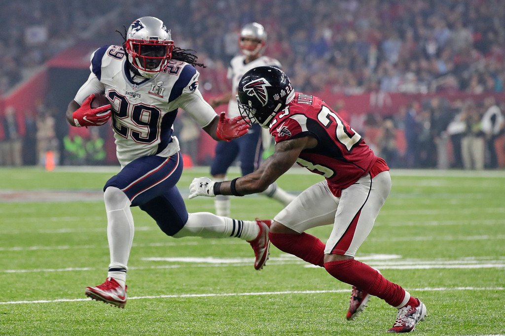 . New England Patriots\' LeGarrette Blount, left, carries against Atlanta Falcons\' Robert Alford during the second half of the NFL Super Bowl 51 football game Sunday, Feb. 5, 2017, in Houston. (AP Photo/Patrick Semansky)