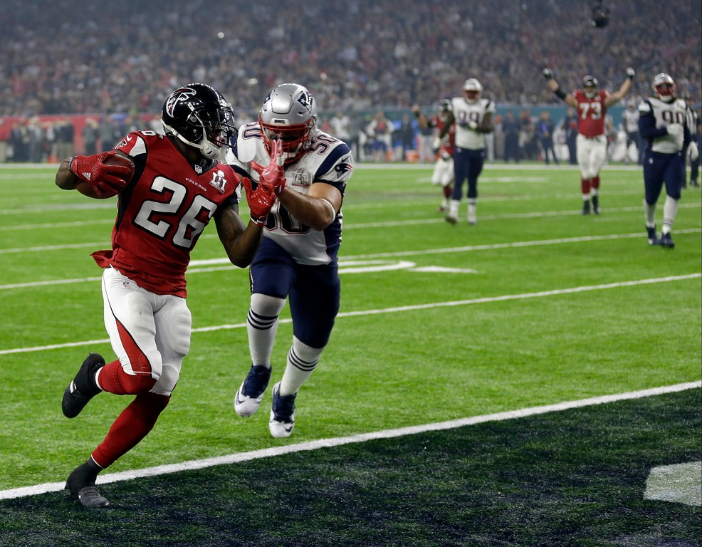 . Atlanta Falcons\' Tevin Coleman (26) runs to the end zone for a touchdown against New England Patriots\' Rob Ninkovich (50) during the second half of the NFL Super Bowl 51 football game Sunday, Feb. 5, 2017, in Houston. (AP Photo/David J. Phillip)