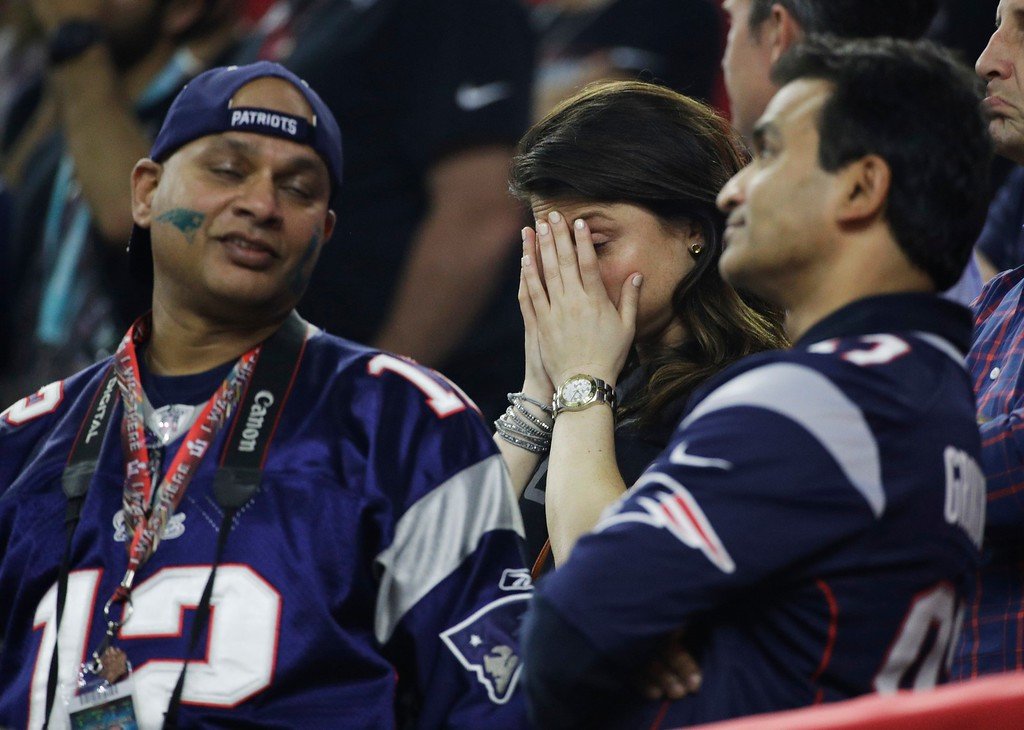 . New England Patriots fans react after Atlanta Falcons\' Tevin Coleman\'s touchdown during the second half of the NFL Super Bowl 51 football game Sunday, Feb. 5, 2017, in Houston. (AP Photo/Jae C. Hong)