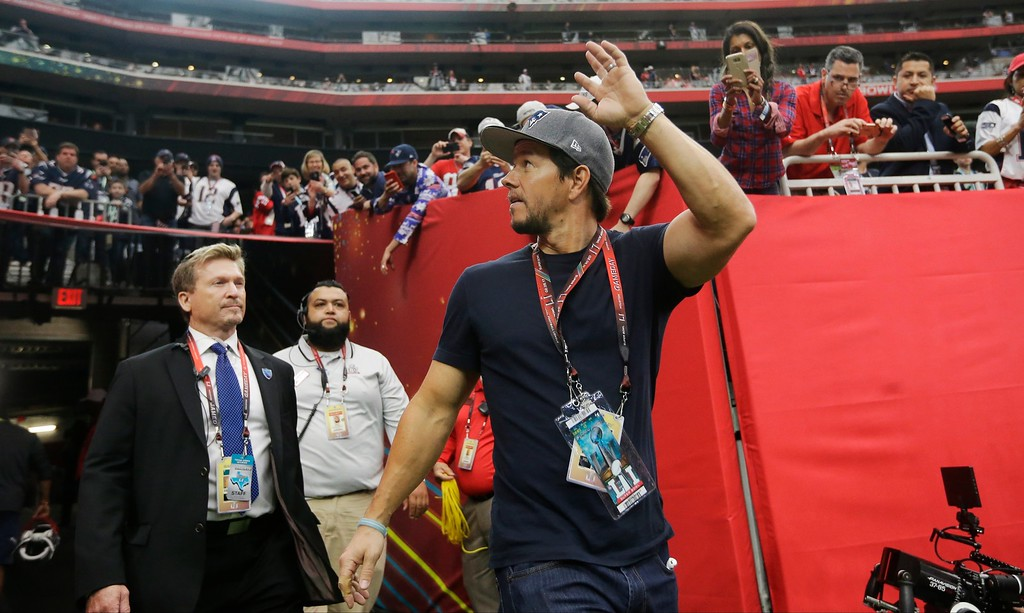 . Mark Wahlberg waves as he arrives before the NFL Super Bowl 51 football game between the New England Patriots and the Atlanta Falcons, Sunday, Feb. 5, 2017, in Houston. (AP Photo/Elise Amendola)