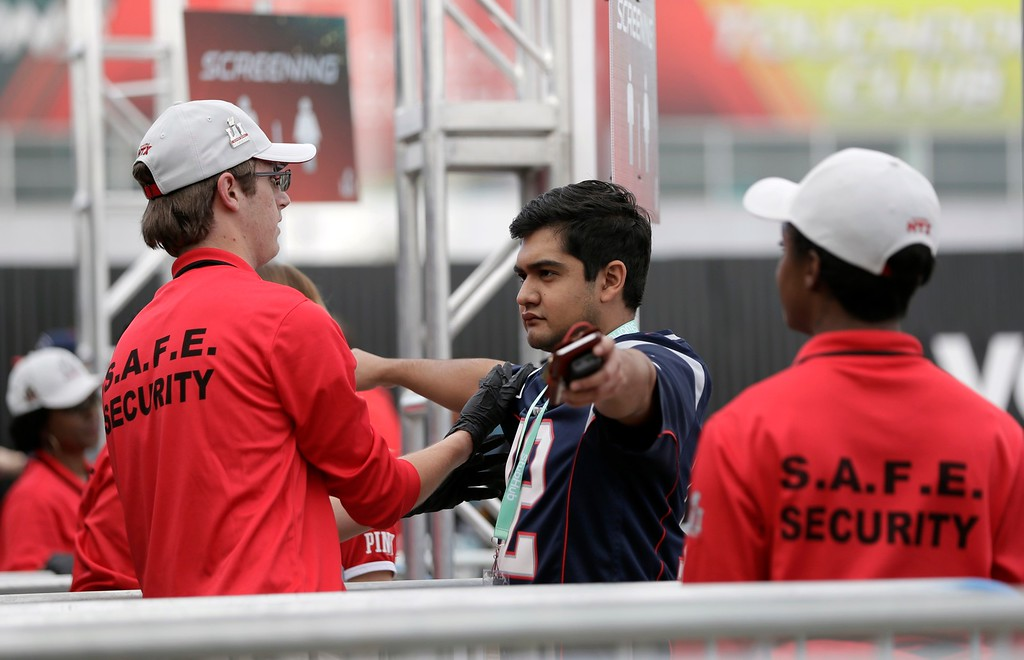 . A fan goes through security screening as he arrives at NRG Stadium before the NFL Super Bowl 51 football game between the Atlanta Falcons and the New England Patriots Sunday, Feb. 5, 2017, in Houston. (AP Photo/Mark Humphrey)
