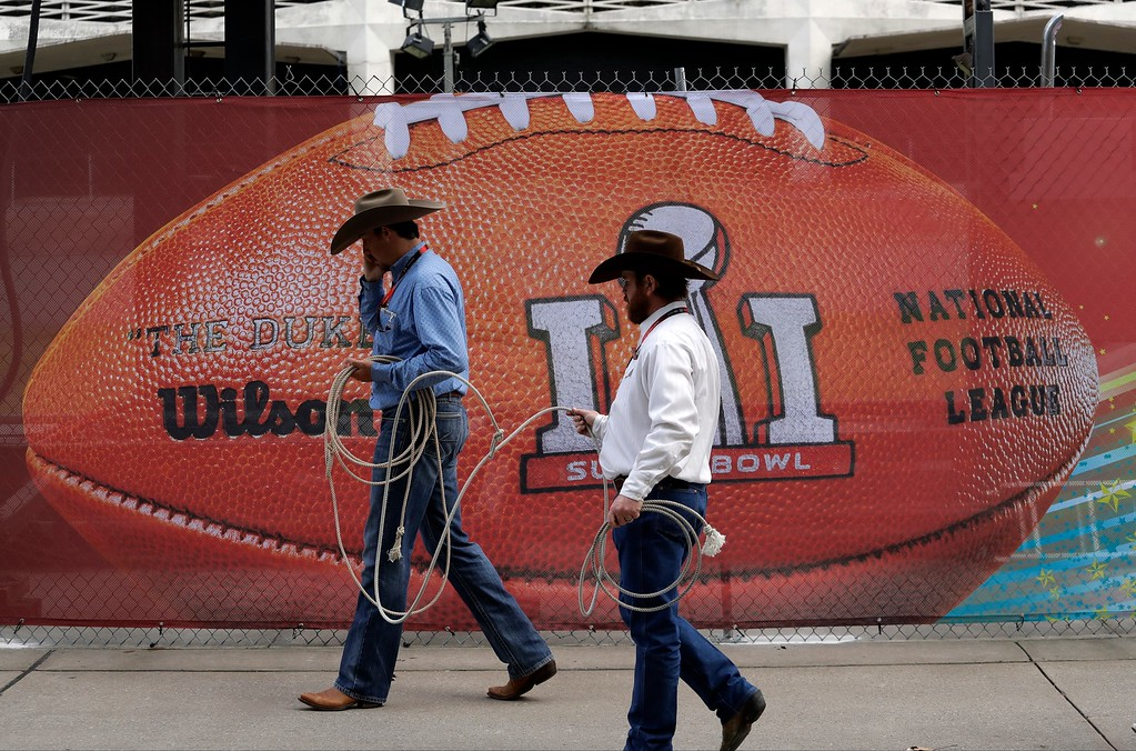 . Performers walk outside of NRG Stadium before the NFL Super Bowl 51 football game between the Atlanta Falcons and the New England Patriots Sunday, Feb. 5, 2017, in Houston. (AP Photo/Eric Gay)