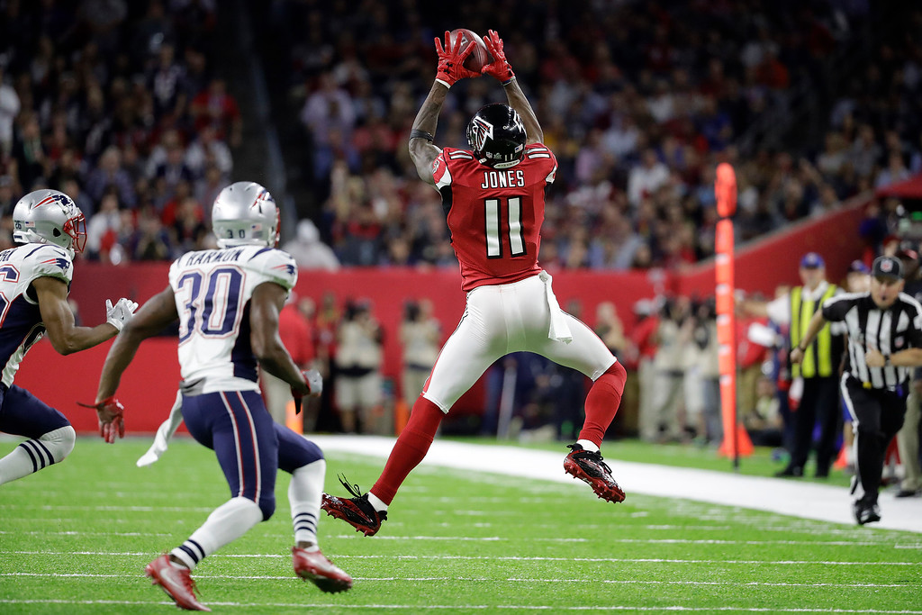 . Atlanta Falcons\' Julio Jones catches a pass against the New England Patriots during the first half of the NFL Super Bowl 51 football game Sunday, Feb. 5, 2017, in Houston. (AP Photo/Tony Gutierrez)