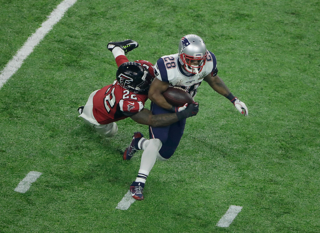 . New England Patriots\' James White, right, is tackled by Atlanta Falcons\' Keanu Neal during the second half of the NFL Super Bowl 51 football game Sunday, Feb. 5, 2017, in Houston. (AP Photo/Charlie Riedel)