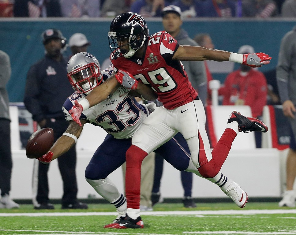 . Atlanta Falcons\' C.J. Goodwin breaks up a pass intended for New England Patriots\' Dion Lewis (33) during the second half of the NFL Super Bowl 51 football game Sunday, Feb. 5, 2017, in Houston. (AP Photo/Mark Humphrey)