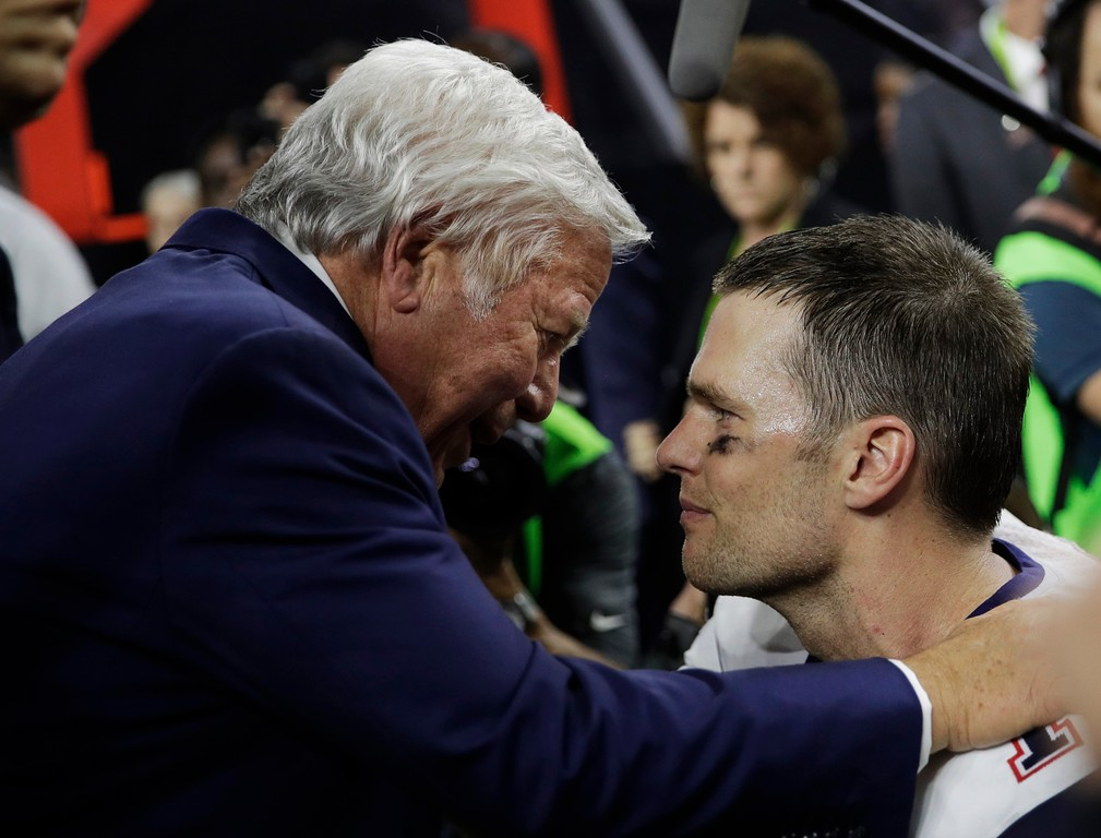 . New England Patriots owner Robert Kraft and Tom Brady meet after the NFL Super Bowl 51 football game against the Atlanta Falcons, Sunday, Feb. 5, 2017, in Houston. (AP Photo/Jae C. Hong)