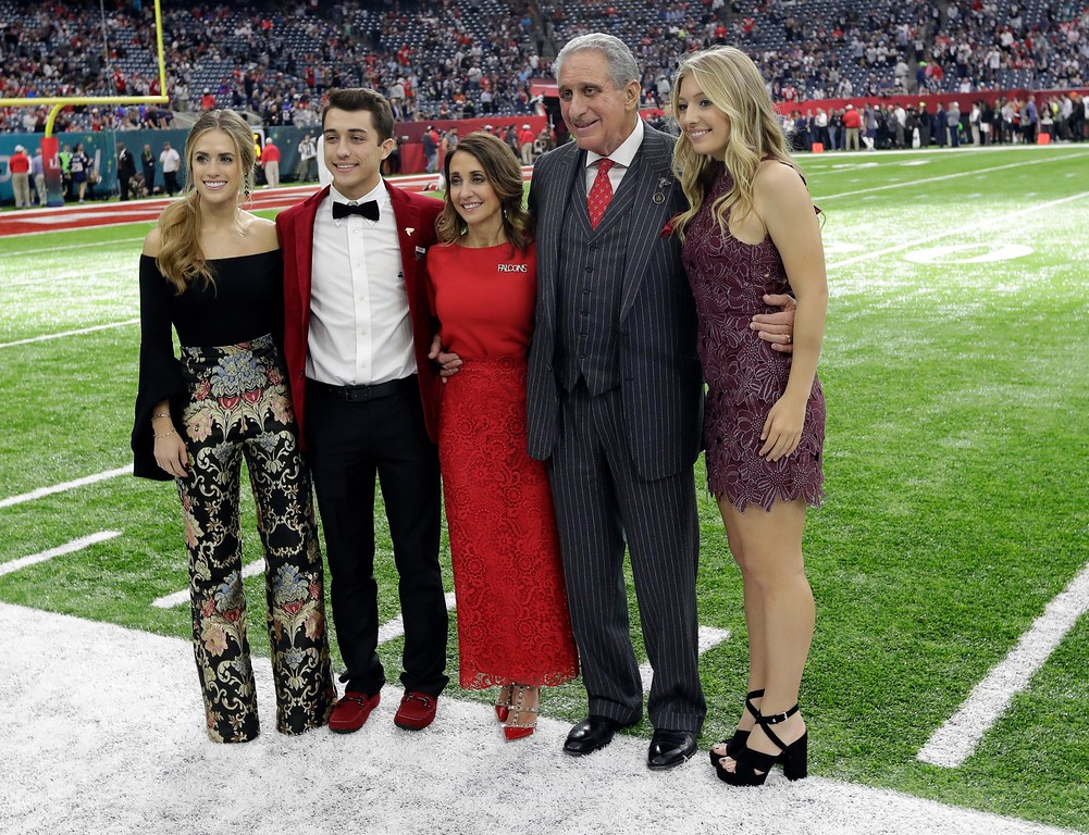 . Atlanta Falcons owner Arthur Blank, second from right, poses with his family for a picture before the NFL Super Bowl 51 football game between the Atlanta Falcons and the New England Patriots Sunday, Feb. 5, 2017, in Houston. (AP Photo/David J. Phillip)