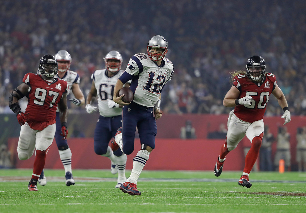 . New England Patriots\' Tom Brady runs against the Atlanta Falcons during the second half of the NFL Super Bowl 51 football game Sunday, Feb. 5, 2017, in Houston. (AP Photo/Elise Amendola)
