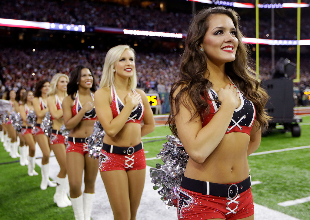 . Atlanta Falcons cheerleaders listen during the National Anthem before the NFL Super Bowl 51 football game between the Atlanta Falcons and the New England Patriots, Sunday, Feb. 5, 2017, in Houston. (AP Photo/Mark Humphrey)