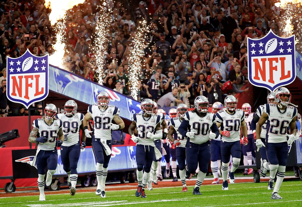 . New England Patriots players take the field before the NFL Super Bowl 51 football game against the Atlanta Falcons Sunday, Feb. 5, 2017, in Houston. (AP Photo/David J. Phillip)