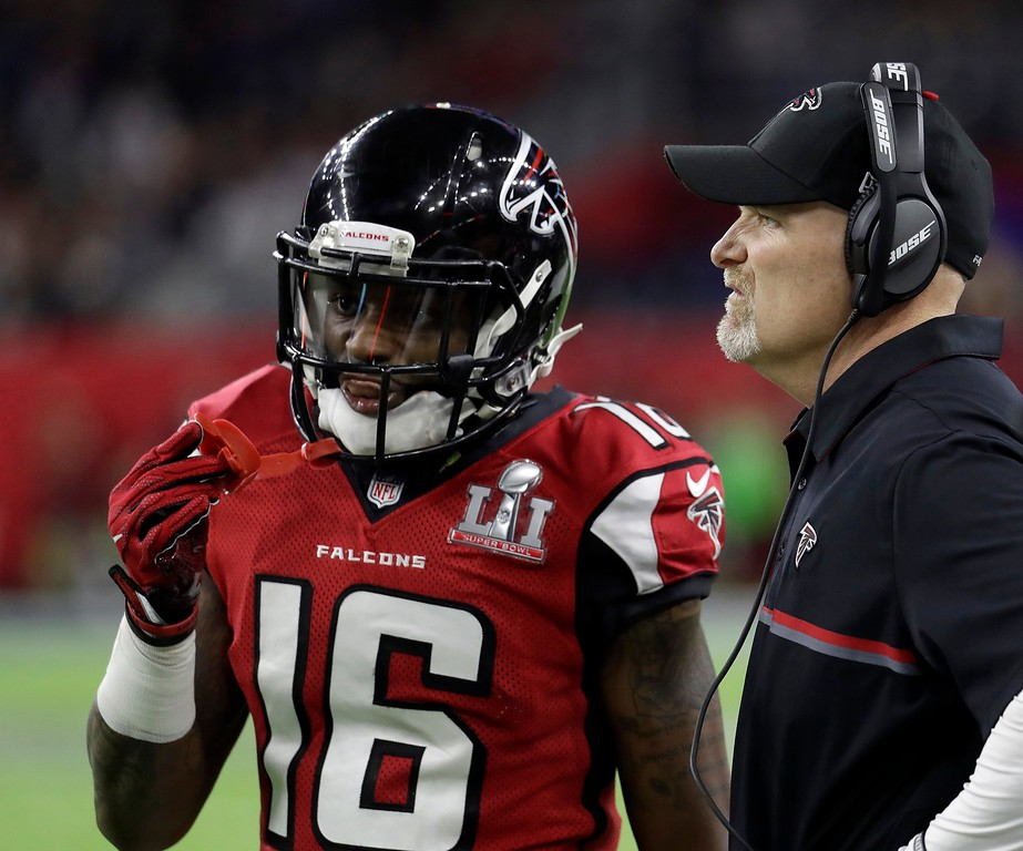 . Atlanta Falcons head coach Dan Quinn, right, talks to Justin Hardy during the first half of the NFL Super Bowl 51 football game against the New England Patriots Sunday, Feb. 5, 2017, in Houston. (AP Photo/Eric Gay)