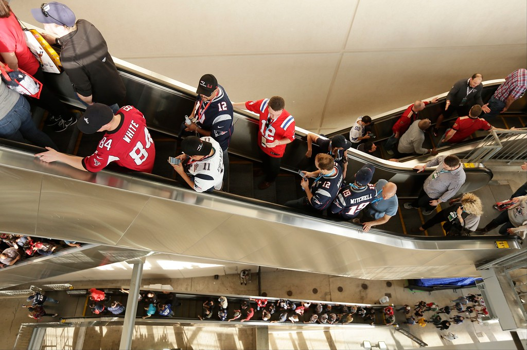 . Fans arrive before the NFL Super Bowl 51 football game between the Atlanta Falcons and the New England Patriots, Sunday, Feb. 5, 2017, in Houston. (AP Photo/Charlie Riedel)