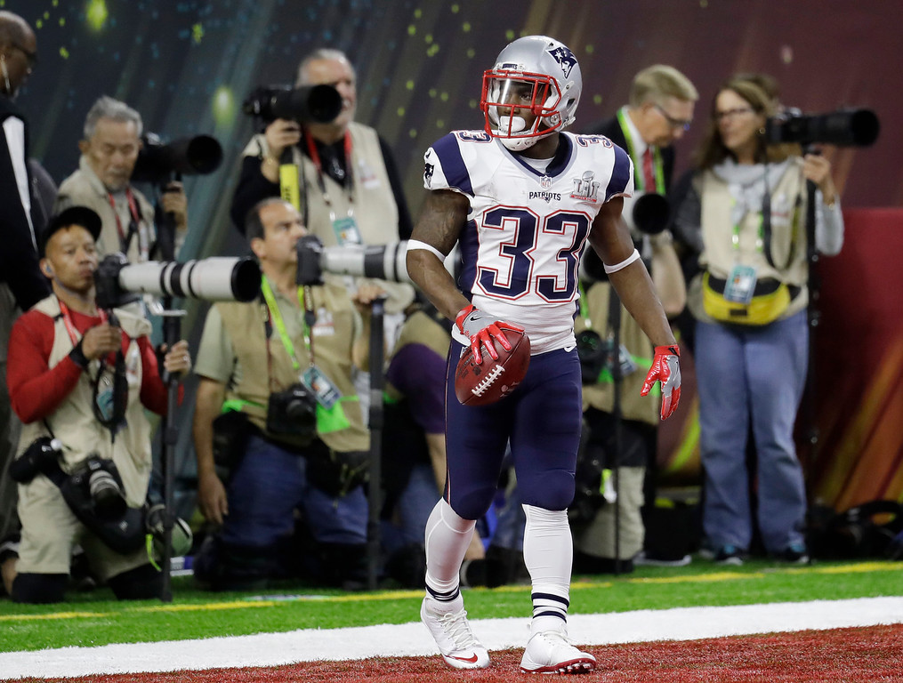 . New England Patriots\' Dion Lewis plays against the Atlanta Falcons during the first half of the NFL Super Bowl 51 football game Sunday, Feb. 5, 2017, in Houston. (AP Photo/Eric Gay)