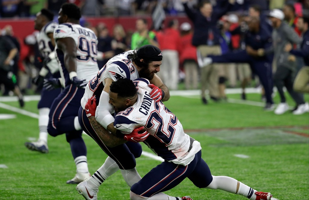. New England Patriots\' Nate Ebner and Patrick Chung celebrate after winning 34-28 in overtime of the NFL Super Bowl 51 football game against the Atlanta Falcons Sunday, Feb. 5, 2017, in Houston. (AP Photo/Eric Gay)
