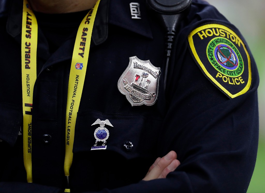 . A Houston police officer guards outside NRG Stadium before the NFL Super Bowl 51 football game between the Atlanta Falcons and the New England Patriots Sunday, Feb. 5, 2017, in Houston. (AP Photo/Eric Gay)