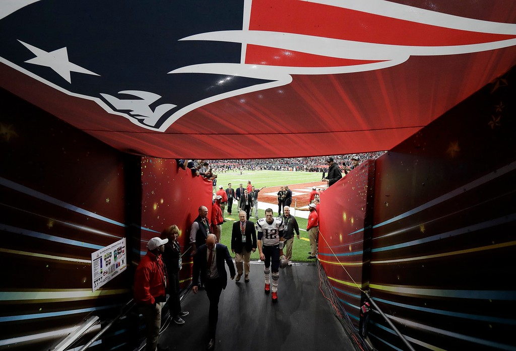 . New England Patriots\' Tom Brady walks off the field after warming up before the NFL Super Bowl 51 football game against the Atlanta Falcons Sunday, Feb. 5, 2017, in Houston. (AP Photo/Elise Amendola)