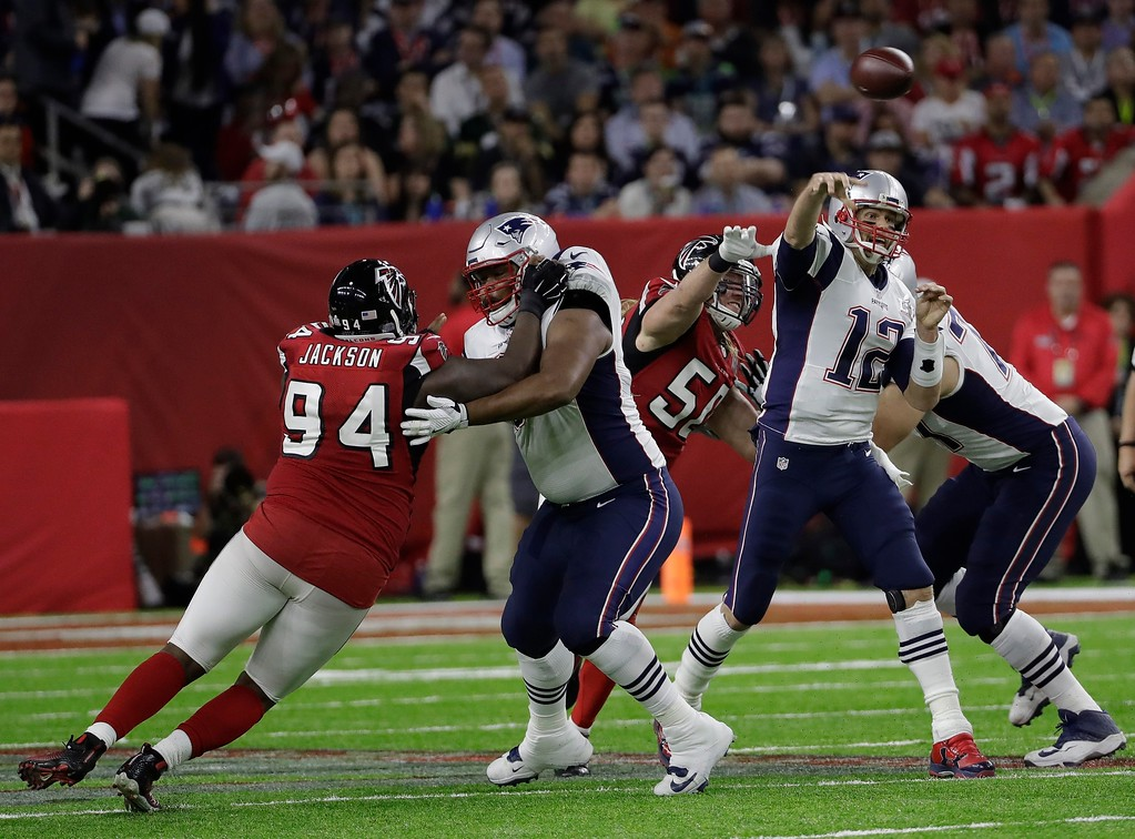 . New England Patriots\' Tom Brady throws under pressure during the first half of the NFL Super Bowl 51 football game against the Atlanta Falcons Sunday, Feb. 5, 2017, in Houston. (AP Photo/David J. Phillip)