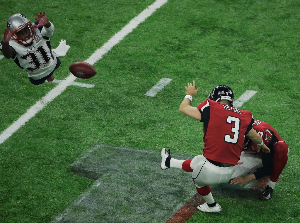 . New England Patriots\' Jonathan Jones, left, fails to block an extra point kick by Atlanta Falcons\' Matt Bryant during the second half of the NFL Super Bowl 51 football game Sunday, Feb. 5, 2017, in Houston. (AP Photo/Charlie Riedel)