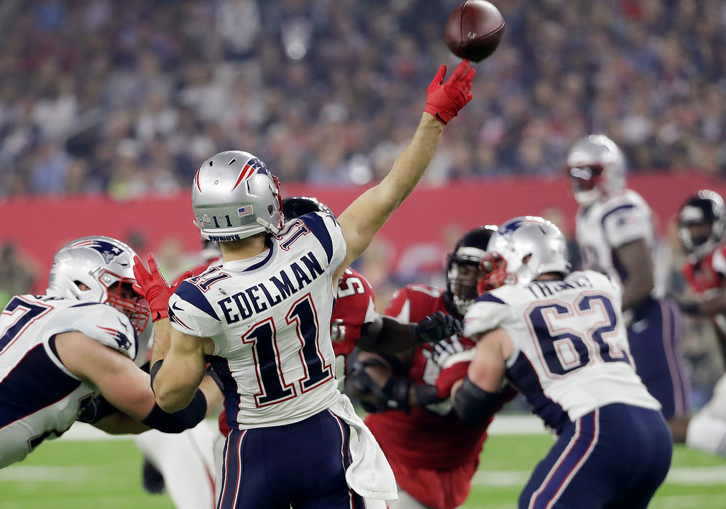 . New England Patriots\' Julian Edelman plays against the Atlanta Falcons during the second half of the NFL Super Bowl 51 football game Sunday, Feb. 5, 2017, in Houston. (AP Photo/David J. Phillip)