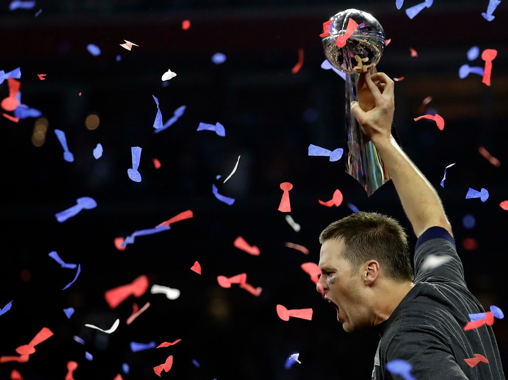 . New England Patriots\' Tom Brady hoists the Vince Lombardi Trophy after the NFL Super Bowl 51 football game against the Atlanta Falcons Sunday, Feb. 5, 2017, in Houston. The New England Patriots won 34-28 in overtime. (AP Photo/Eric Gay)