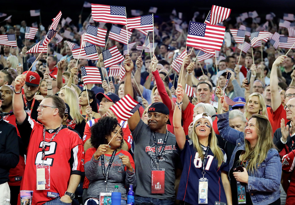 . Fans wave flags before the NFL Super Bowl 51 football game between the Atlanta Falcons and the New England Patriots, Sunday, Feb. 5, 2017, in Houston. (AP Photo/Eric Gay)