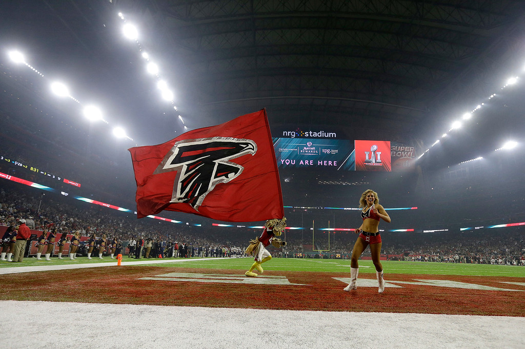 . The Atlanta Falcons mascot and a cheerleader perform during the second half of the NFL Super Bowl 51 football game between the Atlanta Falcons and the New England Patriots Sunday, Feb. 5, 2017, in Houston. (AP Photo/Elise Amendola)