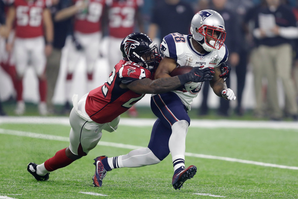 . New England Patriots\' James White carries against Atlanta Falcons\' Keanu Neal during the second half of the NFL Super Bowl 51 football game Sunday, Feb. 5, 2017, in Houston. (AP Photo/Darron Cummings)