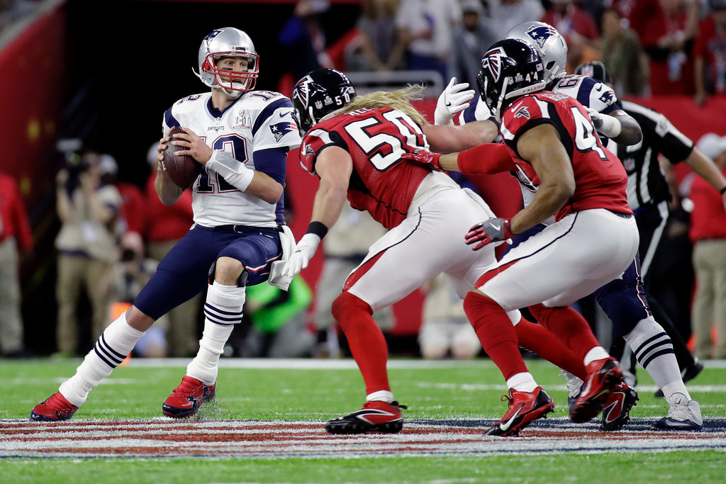 . New England Patriots\' Tom Brady drops back to pass under pressure from Atlanta Falcons\' Brooks Reed in the first half of the NFL Super Bowl 51 football game Sunday, Feb. 5, 2017, in Houston. (AP Photo/Patrick Semansky)