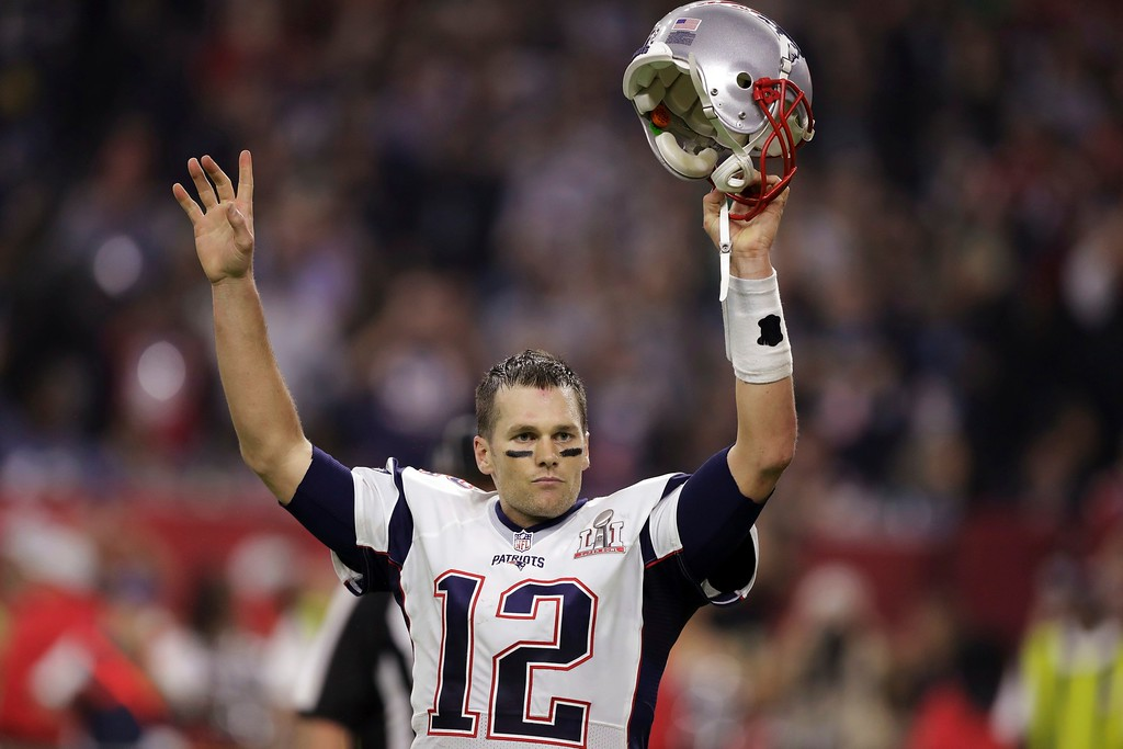 . New England Patriots\' Tom Brady raises his helmet after scoring a touchdown during overtime of the NFL Super Bowl 51 football game against the Atlanta Falcons, Sunday, Feb. 5, 2017, in Houston. The Patriots defeated the Falcons 34-28. (AP Photo/Darron Cummings)
