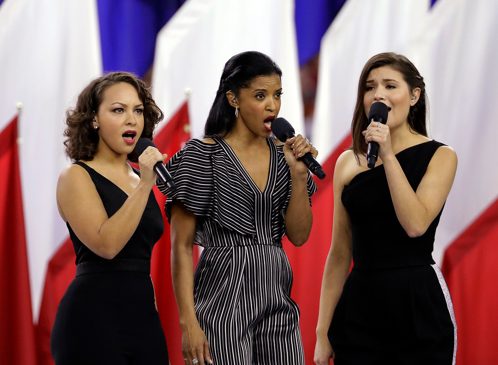 . Cast members of the musical Hamilton sing �God Bless America� before the NFL Super Bowl 51 football game between the Atlanta Falcons and the New England Patriots Sunday, Feb. 5, 2017, in Houston. (AP Photo/David J. Phillip)