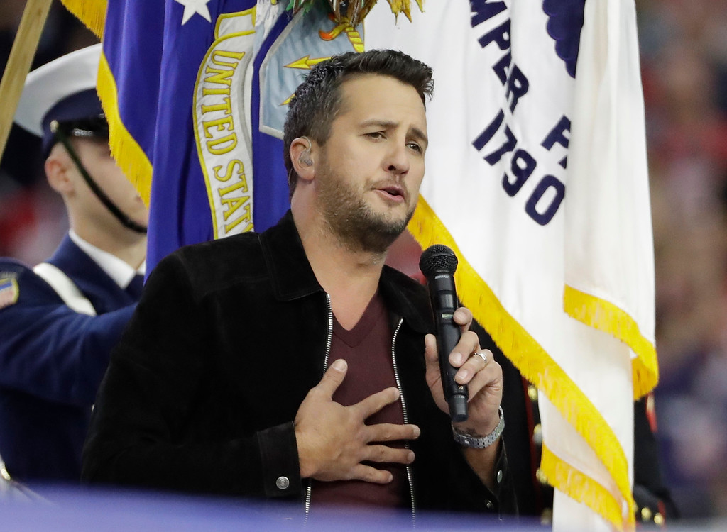 . Singer Luke Bryan sings the national anthem before the NFL Super Bowl 51 football game between the Atlanta Falcons and the New England Patriots Sunday, Feb. 5, 2017, in Houston. (AP Photo/David J. Phillip)