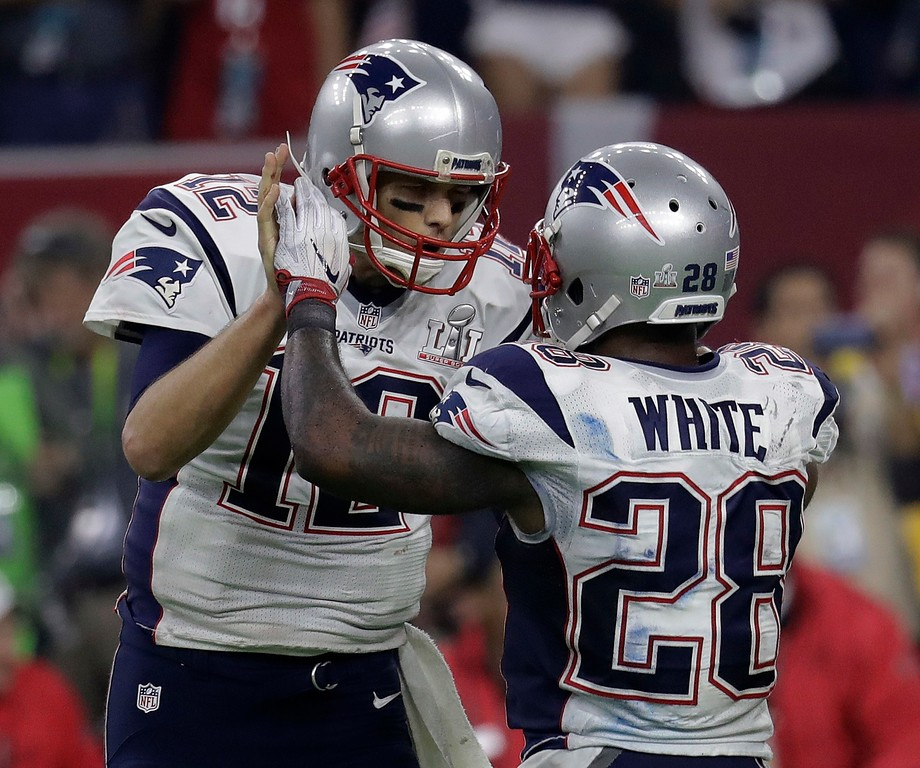. New England Patriots\' Tom Brady celebrates with James White after a touchdown play during the second half of the NFL Super Bowl 51 football game against the Atlanta Falcons Sunday, Feb. 5, 2017, in Houston. (AP Photo/Eric Gay)