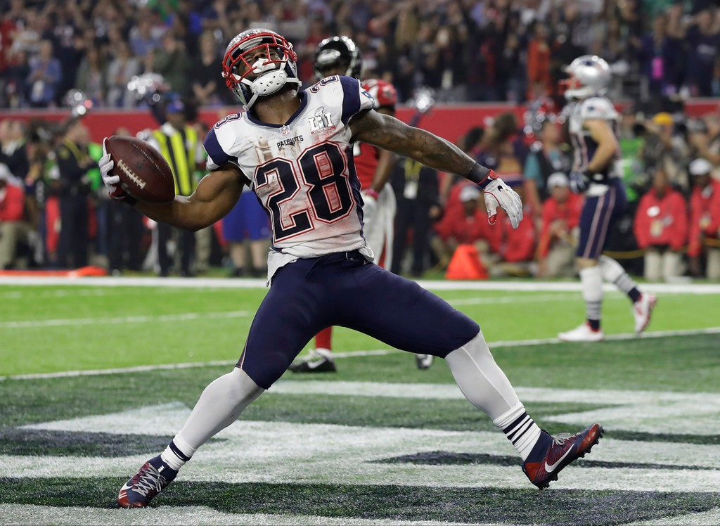 . New England Patriots\' James White celebrates after scoring a touchdown during the second half of the NFL Super Bowl 51 football game against the Atlanta Falcons, Sunday, Feb. 5, 2017, in Houston. (AP Photo/Chuck Burton)
