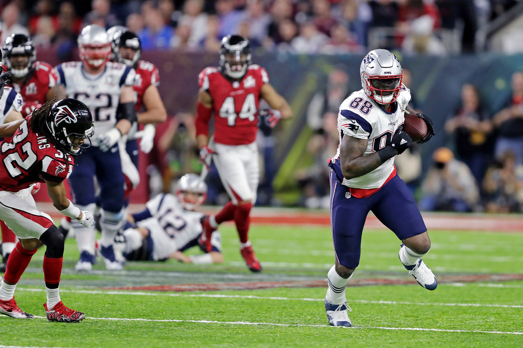 . New England Patriots\' Martellus Bennett carries the ball past Atlanta Falcons\' Jalen Collins, leftis, during the first half of the NFL Super Bowl 51 football game Sunday, Feb. 5, 2017, in Houston. (AP Photo/Darron Cummings)