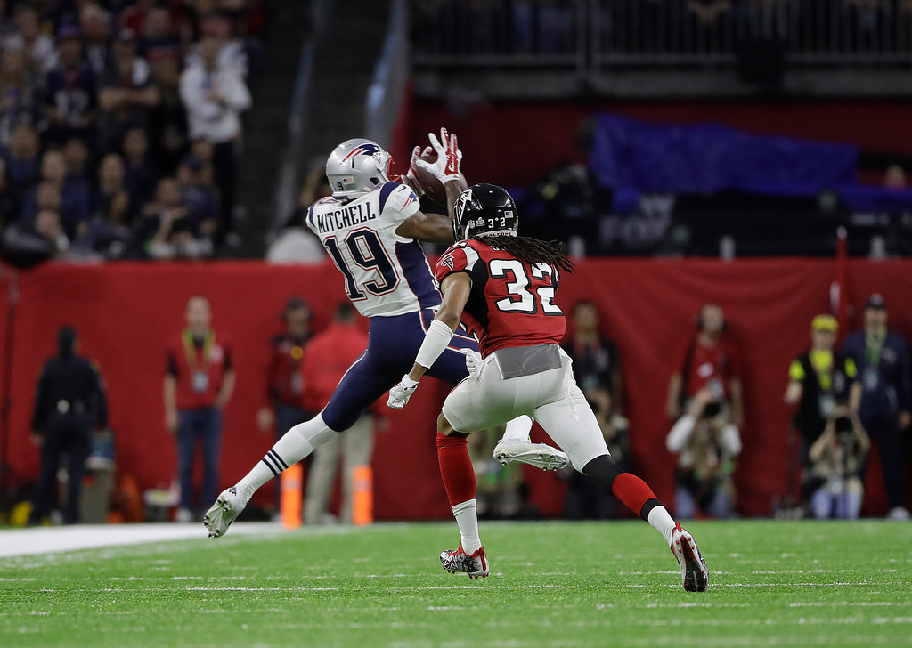 . New England Patriots\' Malcolm Mitchell (19) catches a pass against Atlanta Falcons\' Jalen Collins during the first half of the NFL Super Bowl 51 football game Sunday, Feb. 5, 2017, in Houston. (AP Photo/Elise Amendola)